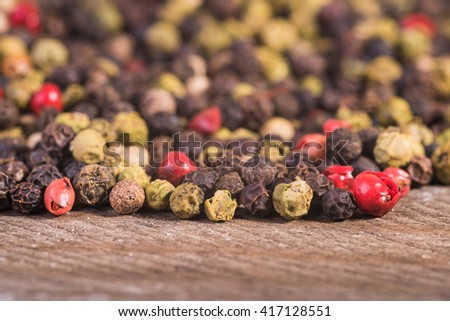 Colored pepper on a wooden background. - stock photo