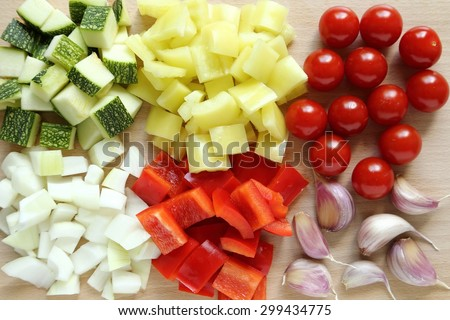 Colored peppers and onions diced on a chopping board. - stock photo