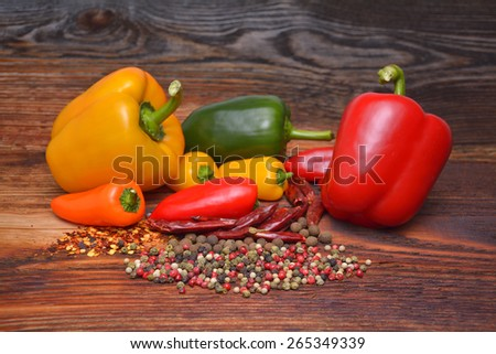 Colored peppers, chili peppers and spice - stock photo