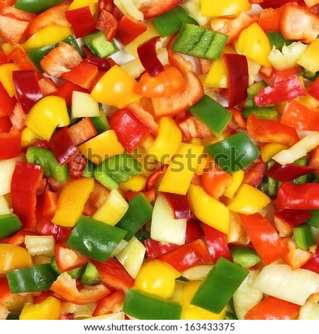 Colored peppers diced on a chopping board - stock photo
