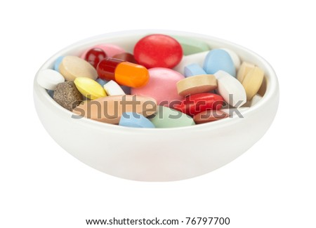 Colored pills in white bowl