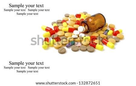 Colored pills, tablets and bottle on a white background - stock photo