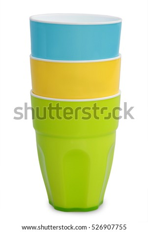 Colored plastic cups isolated on white background