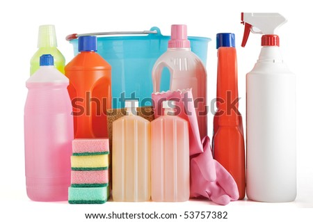 Colored plastic detergent bottles with bucket, sponges and gloves isolated on white background with clipping path