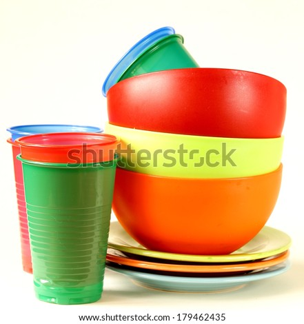 colored plastic tableware (cups, bowls, plates) - stock photo