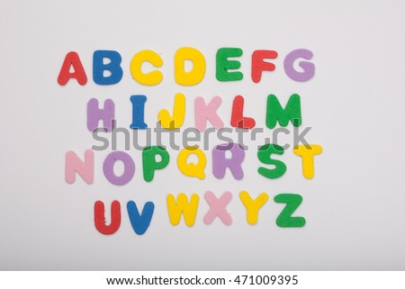 colored, playful lettering spelling out the english alphabet. isolated on white, studioshoot
