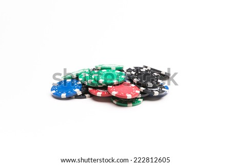 Colored poker chips isolated on white background - stock photo