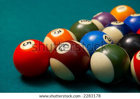 colored pool balls on felt, shallow DOF. - stock photo