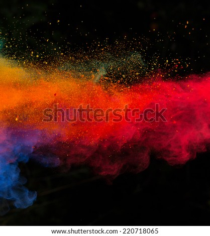 Colored powder isolated on black background - stock photo