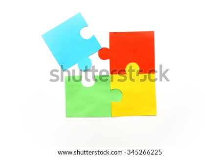Colored puzzle pieces isolated on white background - stock photo