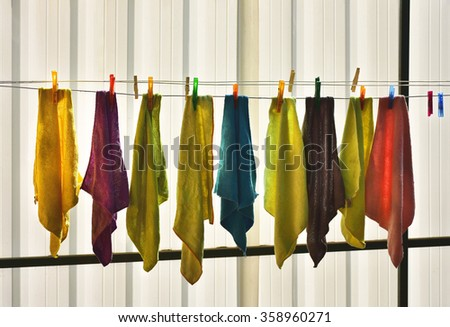 Colored rags on clothesline - stock photo