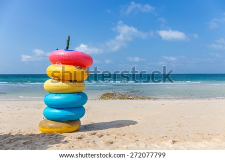 Colored ring on the beach at Koh Larn island ,Pattaya, Chonburi, Thailand. - stock photo