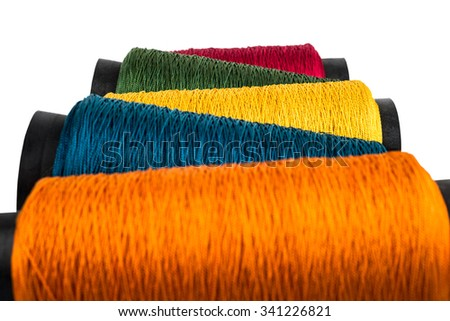 colored rope, thread and sewing accessories - stock photo