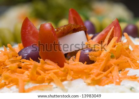Colored salad with olives, tomato, carrots,...