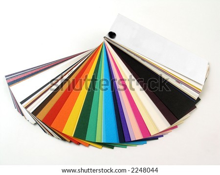 Colored samples of different papers on white background, business cards