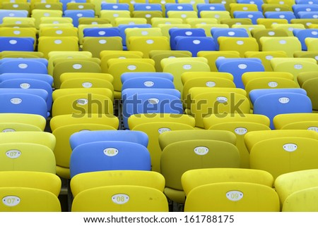 Colored Seating rows in a Maracana stadium with weathered chairs, Rio de Janeiro, Brazil - Latin America - stock photo