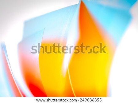 Colored sheets of paper with yellow,orange and blue colors - stock photo
