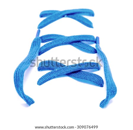 Colored shoelaces on a white background