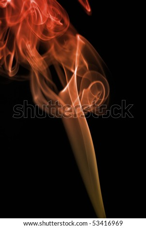 Colored smoke on the black background - stock photo