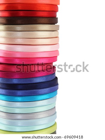 Colored spools of ribbon isolated on white - stock photo