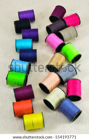 colored spools of threads  - stock photo