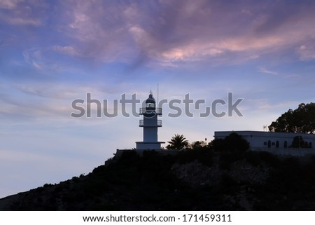 Colored sunset in the coast linea and lighthouse - stock photo