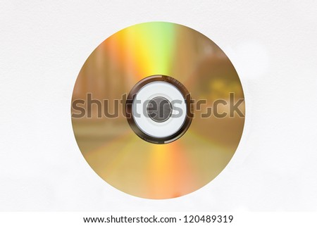 Colored surface of cd against white background. - stock photo