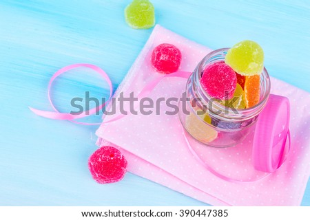Colored sweets. candy and jelly on a bright background. marmalade of different colors on a bright background for the holidays and birthdays. - stock photo