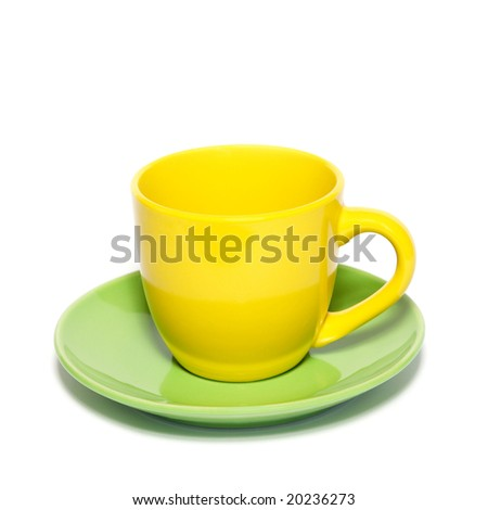 Colored teacup and saucer isolated on white.