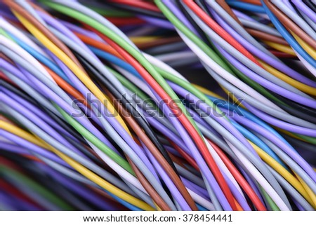 Colored telecommunications cables and wires - stock photo