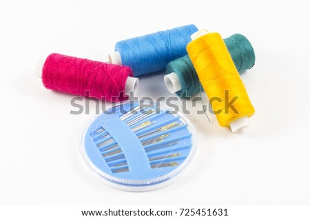 colored thread on white background