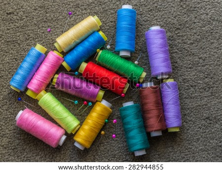 Colored threads and pins - stock photo