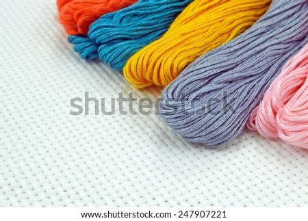 Colored threads for embroidery cross on canvas