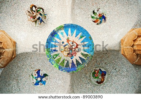 Colored tile mosaic on the ceiling of the Hypostyle Hall in Parc Guell in Barcelona. - stock photo
