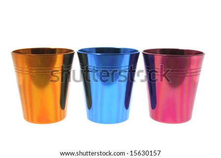 Colored Tin Cups on Isolated White Background