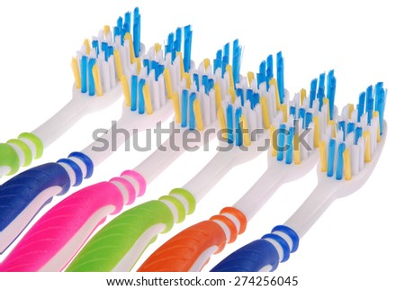 Colored toothbrushes. Isolated on white background. Clipping path included. - stock photo