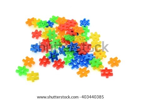 Colored toy blocks isolated on a white background.