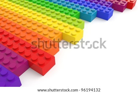 Colored toy bricks on white background. - stock photo