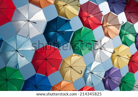 colored umbrellas oblique view - stock photo
