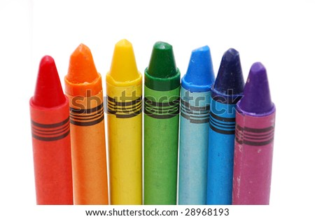 Colored vax crayons standing isolated on white background - stock photo