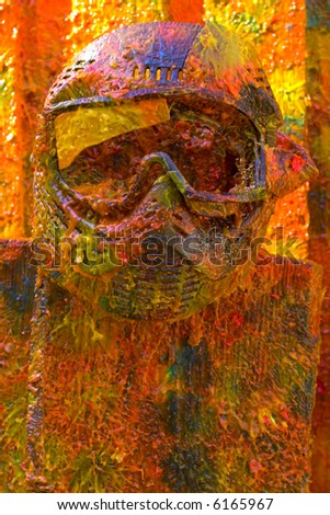 Colored vivid paintball sport protection mask on the fence - stock photo
