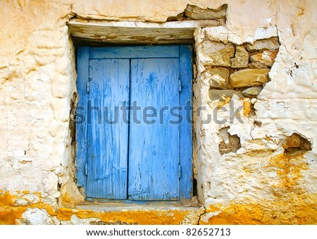Colored Window in old Greek house - stock photo