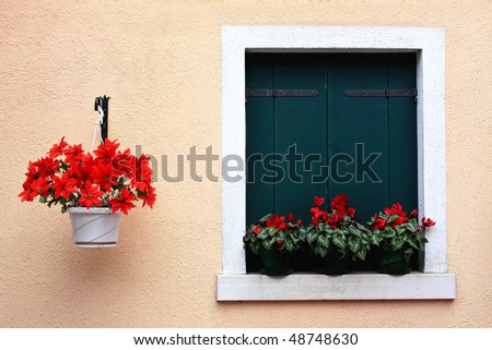 Colored windows of Burano, Venice, Italy. - stock photo