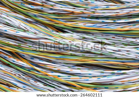 Colored wires in the global telecommunications networks  - stock photo