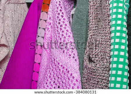 colored women's clothes hangs on a hanger horizontal,very soft focus - stock photo