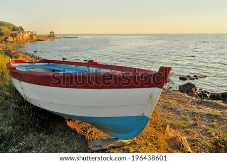 Colored wooden boat at sunset