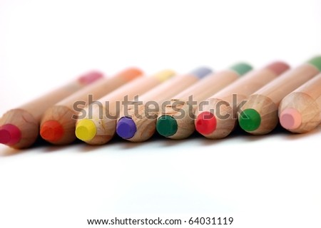 colored wooden pencils closeup over white backgroud