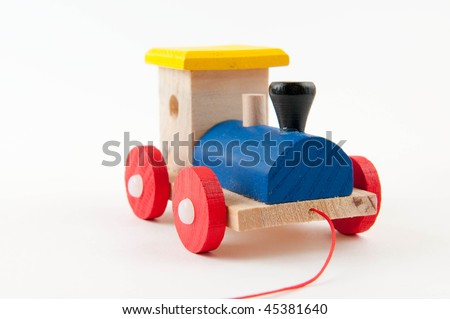 Colored wooden toy train on white background - stock photo