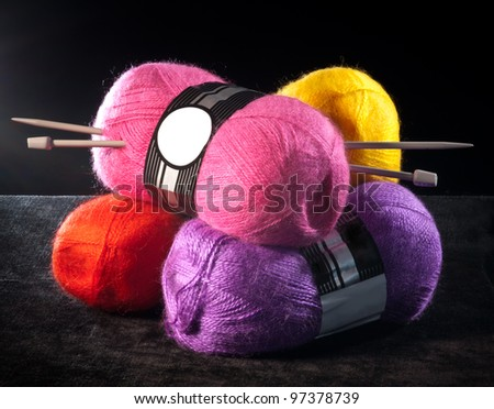 colored yarn with knitting needles - stock photo