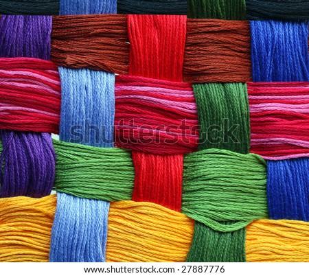 Colorful abstract background made by embroidery threads - stock photo